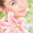 Cute woman with flower — Stock Photo #26078431