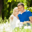 Young happy couple in park — Stok Fotoğraf #26078489