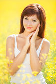 Cute woman in the yellow field — Stock Photo