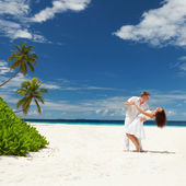 Happy couple on the tropical beach — Stock Photo