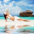 Cute woman relaxing on the tropical beach — Stock Photo #28038639