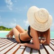 Young fashion woman relaxing on the beach — Stock Photo