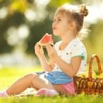 Cute little girl eating watermelon — Stock Photo #31613287