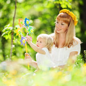 Happy mother and daughter playing in the park — Stock Photo