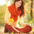 Young pretty woman relaxing in the autumn park — Stock Photo #34323439