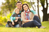 Happy mother, father and daughter in the park — Fotografia Stock