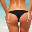 Sexy woman buttocks on the beach background — Stock Photo #34872305