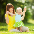 Mother and daughter in the park — Stock Photo #34872329