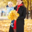 Mother with son in the autumn park — Stock Photo