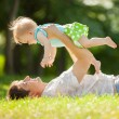 Stock Photo: Happy father and daughter in the park