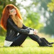Fashion woman relaxing in the park — Stockfoto