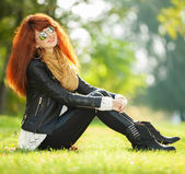 Fashion woman relaxing in the park — Stock Photo