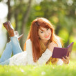 Young pretty woman with tablet in the park — Stok fotoğraf