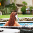 Beautiful woman relaxing in jacuzzi at spa center — Stock Photo