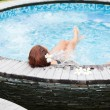 Stock Photo: Beautiful womrelaxing in jacuzzi at spcentre