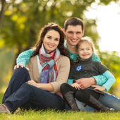Happy family, mother, father and daughter in the park — Stock Photo
