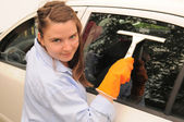 The girl washes the car. — Stock Photo