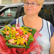 Stock Photo: Womwith bouquet of flowers