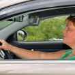 The woman in the car — Stock Photo