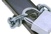 Cell phone on a chain with a lock — Stock Photo