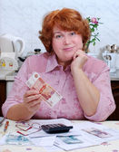 Woman expects utilities — Stock Photo