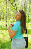 Young girl with a laptop in the forest — Stock Photo