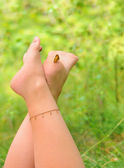 Female legs and little butterfly — Stockfoto