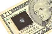 Dollars and electronic chip. The concept of electronic money — Stock Photo