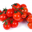 Stock Photo: Cherry tomatoes on branch on white background
