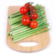 Stock Photo: Green asparagus and cherry tomatoes on cutting board