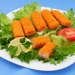 Stock Photo: Fish sticks on lettuce
