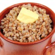 Stock Photo: Buckwheat porridge with butter in clay pot