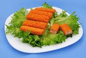 Fish sticks on lettuce — Stock Photo