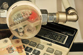 Water meter, calculator and money — Stock Photo