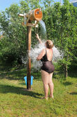 Woman pours cold water — Foto Stock