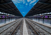 Railway track in station on blue sky background — Stock Photo