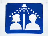 Sign of shower men and women — Stock Photo