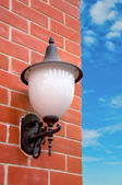 Old street lamp on the wall — Stock Photo