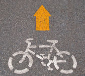The Bicycle sign painted on the pavement — Stock Photo