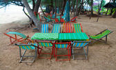 Empty picnic table and chair on beach — Stock Photo