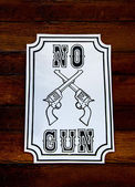 Sign of no weapon allowed on wood wall — Stock Photo