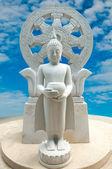Buddha status on blue sky background — Stock Photo