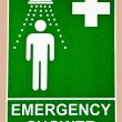 The Sign emergency safety shower on wall background - Stock Photo