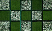 Abstract of artificial grass with stone — Stock Photo