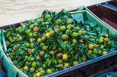 Fresh orange on boat — Stock Photo