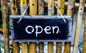 Sign wooden of open door — Stock Photo