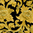Golden flower of bas-relief pattern thai style — Stock Photo