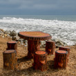 Empty picnic table on beach — Stock Photo #19601395