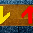 Royalty-Free Stock Photo: The Red arrow and  yellow arrow on floor background