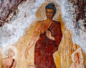 The Old painting of buddha status in cave — Stock Photo